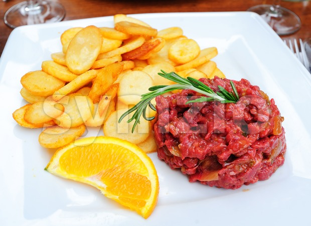 Steak tartare served with french fries potato chips Stock Photo