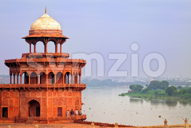 Red corner tower of Taj Mahal complex overlooking the river in Agra, India