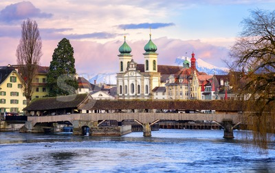 Lucerne, Switzerland, view over the Reuss river to the wooden Spreuer Bridge, Jesuit Church and the Old Town Stock Photo