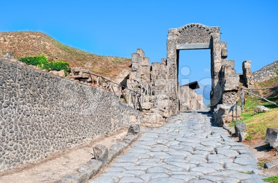 Cobbled street in antique roman town Pompeii, Naples, Italy Stock Photo