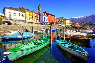 Colorful boats in olt town of Ascona, Ticino, Switzerland Stock Photo