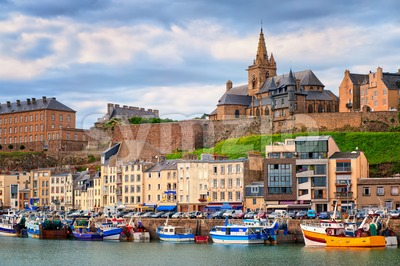 Gothic church on the hill and fishermen boats in port town Granville, Normandy, France Stock Photo