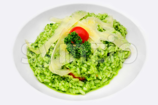 Pesto Risotto with parmesan cheese stripes Stock Photo