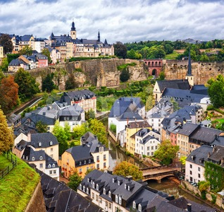 Luxembourg city, view over the Grund to upper town Stock Photo