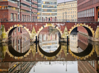Bridge reflecting in canal in Hamburg city, Germany Stock Photo