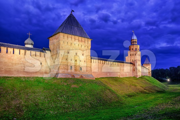 Red walls of Novgorod Kremlin at night, Russia Stock Photo