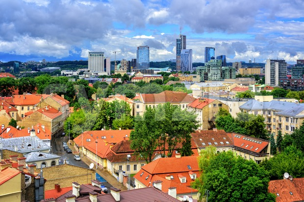 View over the red tiled roofs of the old town of Vilnius to the modern skyline of Financial Centre, Lithuania