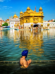 Sikh prayer in lake of Golden Temple, Amritsar, India Stock Photo