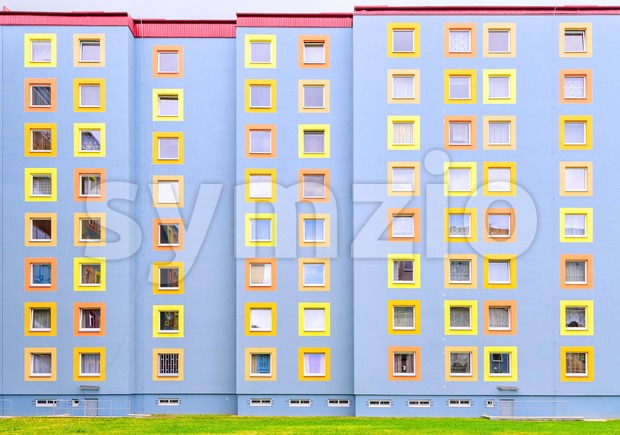 Facade of the modern colorful multistory house Stock Photo