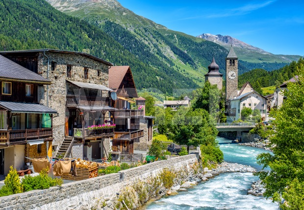 Swiss village in Alps mountains, Grisons, Switzerland Stock Photo