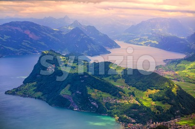 Swiss Alps mountains and Lake Lucerne on dramatic sunset Stock Photo
