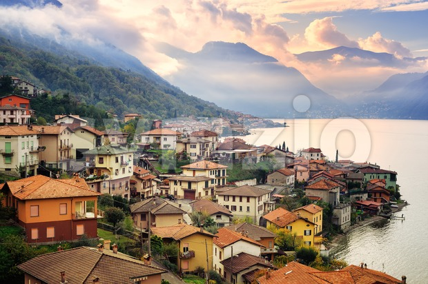 View of Como Lake, Milan, Italy, on sunset with Alps mountains in background Stock Photo