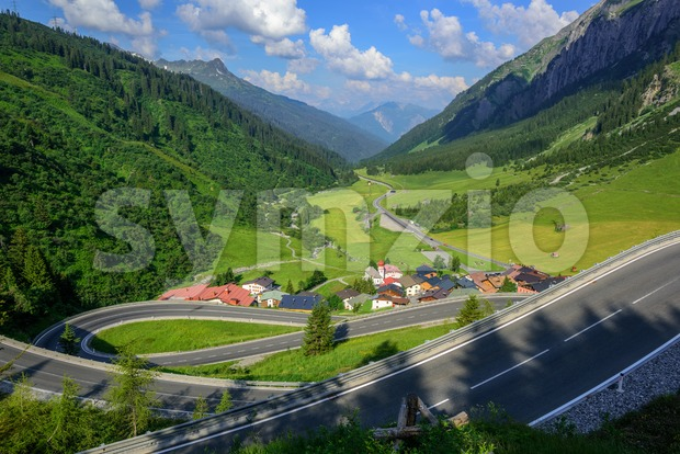 Motorway road winding down in a beautiful valley in the Alps mountain, Tyrol, Austria, on a bright summer day
