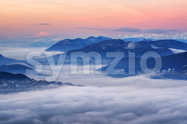 Clouds over Lake Lugano and swiss Alps, Switzerland Stock Photo