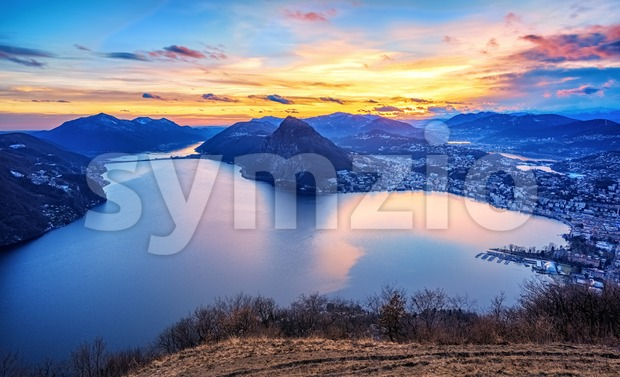 Dramatic sunset over Lake Lugano in swiss Alps, Switzerland Stock Photo