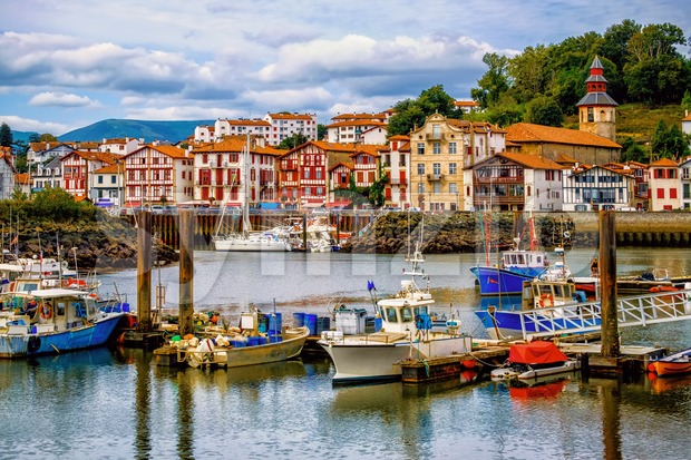 Colorful basque houses in port of Saint-Jean-de-Luz, France Stock Photo
