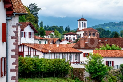 White basque houses in Pyrenees mountains, Saint Jean Pied de Port, France Stock Photo