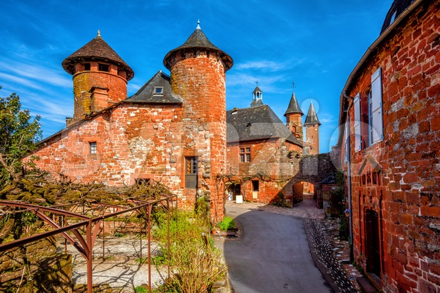 Collonges-la-Rouge, red brick houses and towerd of the Old Town, France Stock Photo