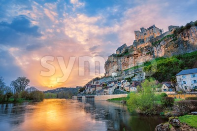 Beynac-et-Cazenac village with medieval Chateau Beynac on dramatic sunset, Dordogne, France Stock Photo