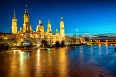 Zaragoza city, Spain, view over river to Cathedral at evening Stock Photo
