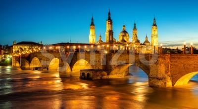 Zaragoza city, Spain, bridge and Cathedral del Pilar at sunset Stock Photo