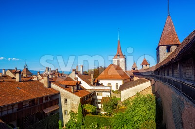 Red tiled roofs and wall towers in Old Town Murten, Switzerland Stock Photo