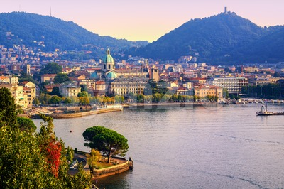 Como city town center on Lake Como, Italy, in warm sunset light Stock Photo