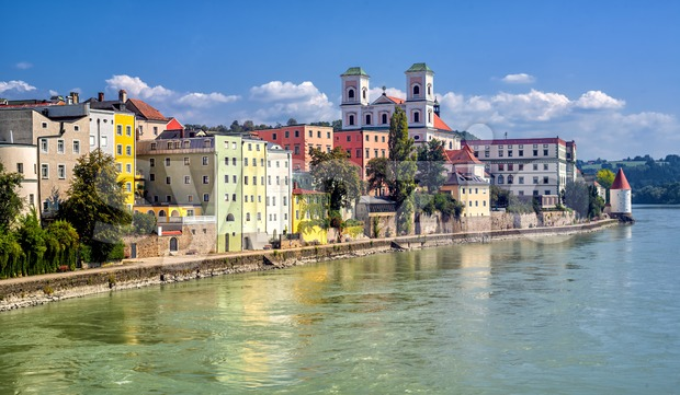 Colorful traditional houses facing Inn river in historical old town Passau, Germany