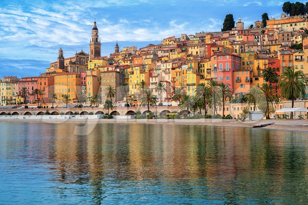 Colorful houses and sand beach in the historical Old Town Menton on french Riviera, France