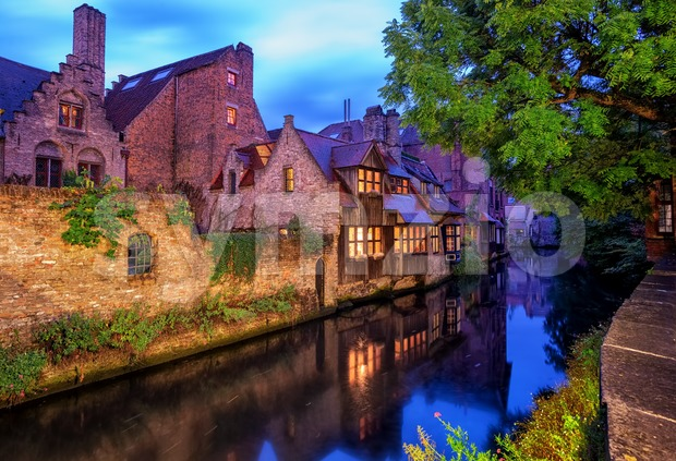 Traditional medieval houses on a canal in historical Bruges Old Town center, Belgium. Bruges is a UNESCO World Culture Heritage ...