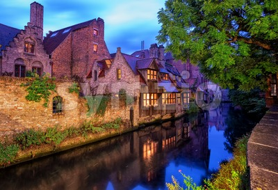 Bruges Old Town, Belgium. Traditional medieval houses on a canal. Stock Photo