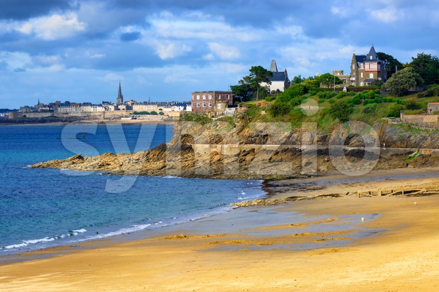 Sand beach Plage Saint-Enogat in Dinard, with view to St Malo Old town and English Channel, Brittany, France