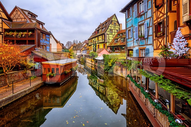 Colmar Old Town, Alsace, France, traditional colorful half-timber houses in little Venice quarter, decorated for Christmas