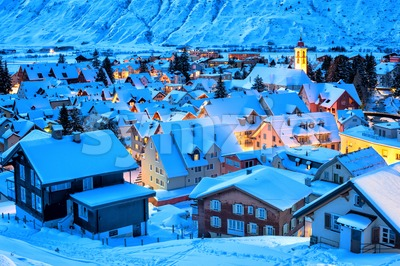 Andermatt village in the Alps mountains, snow covered in winter, Uri, Switzerland Stock Photo