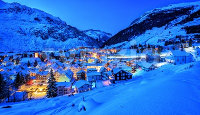 Andermatt village in Alps mountains in winter snow, Uri, Switzerland Stock Photo