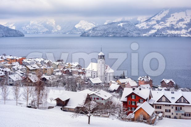 Beckenried village on Lake Lucerne, swiss Alps mountains, Switzerland, view in winter time Stock Photo