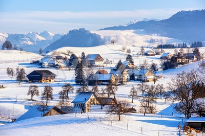 A snow covered village in swiss Alps, Switzerland, in winter time Stock Photo