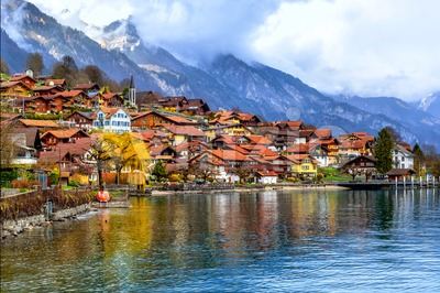 Old town and Alps mountains on Brienzer Lake, Switzerland Stock Photo