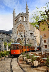 Old tram in front of the Cathedral of Soller, Mallorca, Spain Stock Photo