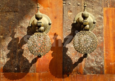 Moroccan decorated bronze door knobs, Morocco Stock Photo