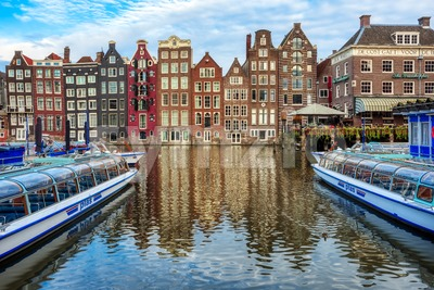 Damrak canal in the Old town of Amsterdam, Netherlands Stock Photo