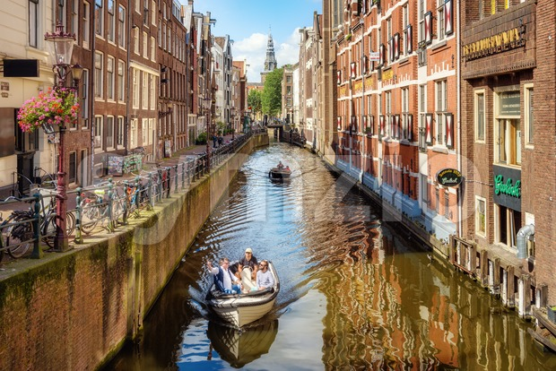 Canal in the Old town of Amsterdam city, Netherlands Stock Photo