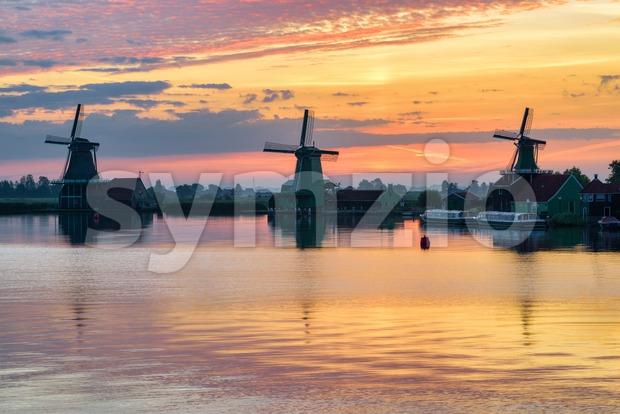 Windmills in Zaanse Schans, Holland, on sunrise Stock Photo