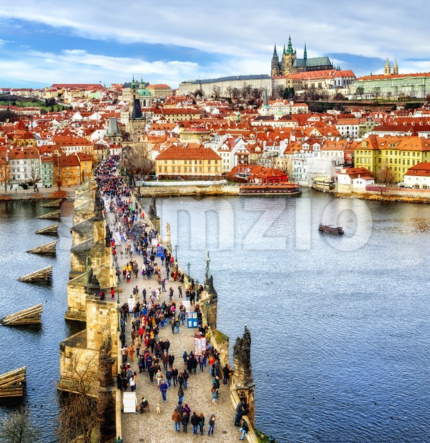 Panorama of Prague with the Castle, Charles Bridge, Vltava river and red roofs of the old town, Czech Republic Stock Photo