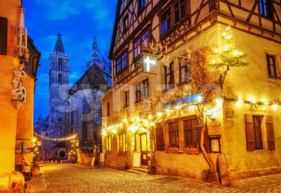 Christmas decoration lights at night in Rothenburg ob der Tauber, Germany Stock Photo