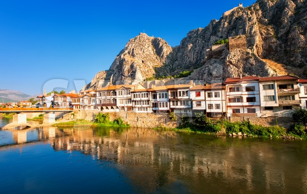 Traditional ottoman houses reflecting in the river, Amasya, Turkey Stock Photo