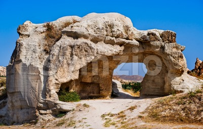 Bizarre hole in a rock formation in Cappadocia, famous tourist destination in central Turkey known for its unique geological landscapes Stock Photo