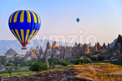 Cappadocia hot air balloon flying over bizarre rock landscape in Turkey Stock Photo