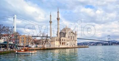 Ortakoy mosque and Bosporus bridge on European side in Istanbul, Turkey Stock Photo