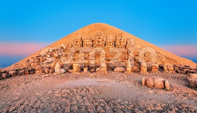 Statues on the summit of Mount Nemrut in Turkey on sunrise Stock Photo